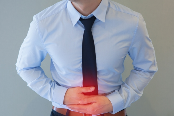 Man in office uniform having a stomachache